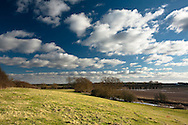 Upper reaches of the River Thames from a hillside on the Thames Path near Cricklade, Wiltshire, Uk