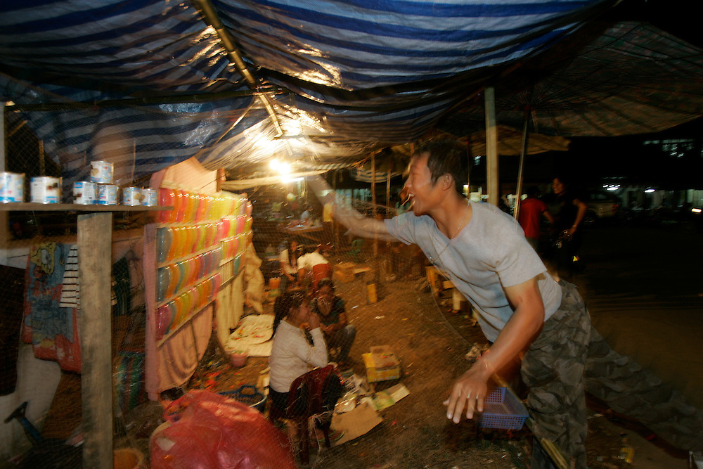A Laotian man plays carnival games at the second annual Elephant Festival in Paklay, Laos, Thursday, Feb. 14, 2008.