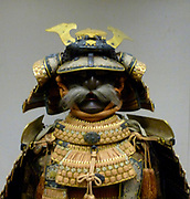 Helmet from a suit of armour belonging to a Japanese Samurai warrior, circa 1560. This suit of armour was made during the  Edo period, during which, samurai wore armour only on ceremonial occasions. lacquered metal joined by silk cords.