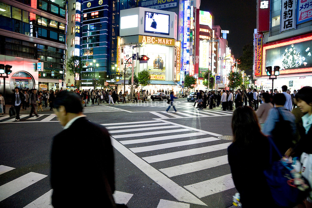 business people crossing at a zebra late in the evening Tokyo Japan