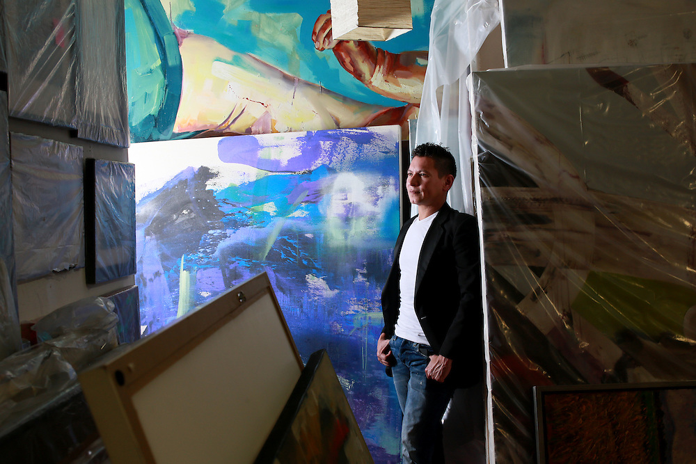 Alexander Salazar sits in his Gallery Alexander Salazar Fine Arts on Tuesday, February 10, 2015 in San Diego, CA(Photo by Sandy Huffaker)
