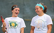 Iowa City West's Addy Riley and Elena Wilson (from left) share a laugh during a doubles match in the Class 2A state team tennis tournament at Veterans Memorial Tennis Center in Cedar Rapids on Saturday, June 1, 2013.