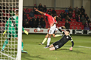 Salford City defender Ibou Touray clear the area during the EFL Sky Bet League 2 match between Salford City and Macclesfield Town at the Peninsula Stadium, Salford, United Kingdom on 23 November 2019.