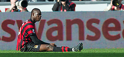 SWANSEA, WALES - Sunday, March 11, 2012: Manchester City's Mario Balotelli lies dejected after not being awarded a penalty against Swansea City during the Premiership match at the Liberty Stadium. (Pic by David Rawcliffe/Propaganda)