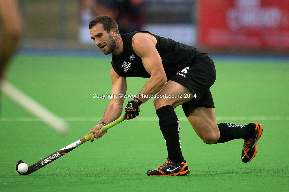 Dane Lett of New Zealand looks to pass during the Black Sticks Men v Japan international hockey match at the Coastlands Kapiti Sports Turf in Paraparaumu on Friday the 21st of November 2014. Photo by Marty Melville/www.Photosport.co.nz