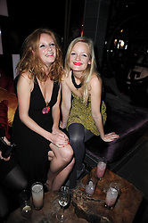 Left to right, sisters OLIVIA INGE and ALEXIA INGE at the Tatler Little Black Book Party held at Chinawhite, 4 Winsley Street, London on 20th November 2009.