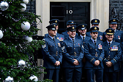 © Licensed to London News Pictures. 14/12/2016. London, UK. Members of Royal Air Force pose for a selfie outside 10 Downing Street in London after meeting with British prime minister Theresa May at a reception for a Military awards. Photo credit: Ben Cawthra/LNP