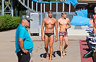 Ian THORPE (C) of Australia and his teammate Erik VAN DOOREN (R) of Switzerland on their way to coach Guennadi TOURETSKI (Gennadi TURETSKI) (L) during a training session held at the 50m outdoor training pool at the Centro sportivo nazionale della gioventu in Tenero, Switzerland, Friday, Sept. 9, 2011. (Photo by Patrick B. Kraemer / MAGICPBK)