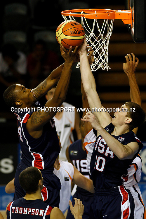 USA's Forward's Amell Moultrie and Gordon Hayward go for a rebound during the USA's 106-55 victory over Iran.<br />