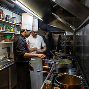 Chefs in an Indian restaurant at work.