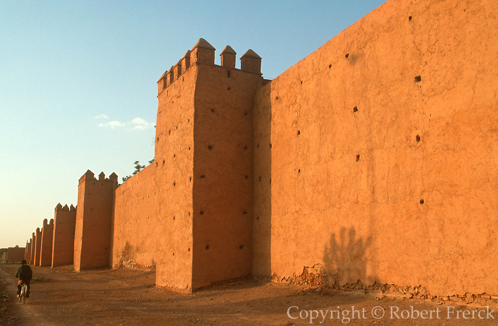 MOROCCO, MARRAKECH a section of the famous, thick, red adobe  walls and towers surrounding the old city