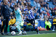 Kadeem Harris of Sheffield Wednesday pushes Ryan Manning of Queens Park Rangers after being fouled during the EFL Sky Bet Championship match between Sheffield Wednesday and Queens Park Rangers at Hillsborough, Sheffield, England on 31 August 2019.