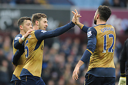 Aaron Ramsey of Arsenal celebrates his goal with Mesut Ozil and Olivier Giroud - Mandatory byline: Dougie Allward/JMP - 13/12/2015 - Football - Villa Park - Birmingham, England - Aston Villa v Arsenal - Barclays Premier League
