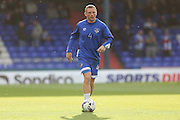Brian Wilson of Oldham Athletic warms up before the EFL Cup match between Oldham Athletic and Wigan Athletic at Boundary Park, Oldham, England on 9 August 2016. Photo by Simon Brady.