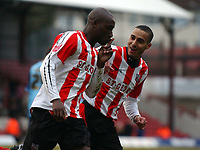 Photo: Olly Greenwood.<br />Brentford v Barnsley. Coca Cola League 1. 11/03/2006. Brentford's Llyod Owusu celebrates scoring from the penalty spot.