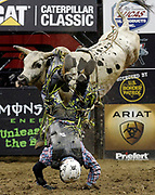 Dylan Smith rides Stretch during a Professional Bull Riders competition at the Sprint Center, in Kansas City, Mo., Sunday, March 24, 2019. (AP Photo/Colin E. Braley)