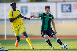 Shamar Amaro Nicholson of NK Domzale and David Kasnik of NK Rudar during football match between NK Domzale and NK Rudar in Round #28 of Prva liga Telekom Slovenije 2017/18, on April 22, 2018 in Sports Park Domzale, Domzale, Slovenia. Photo by Urban Urbanc / Sportida