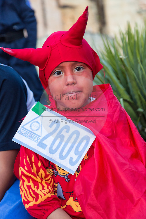 A young boy dressed in a devil costume during the Day of the Dead Festival known in spanish as Día de Muertos on October 25, 2014 in Oaxaca, Mexico.