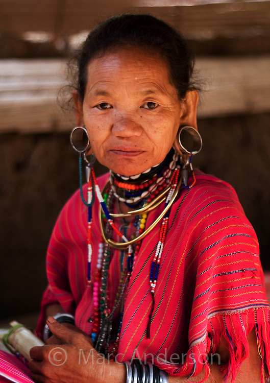 Old woman from Karen hill tribe with stretched ear lobes and wearing traditional dress, Tha Ton, Chiang Mai Province, Thailand