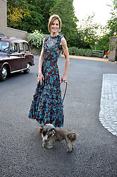 TRINNY WOODALL with her pet dog at the annual Dog's Trust Honours Awards held at The Hurlingham Club, Fulham, London on 19th May 2009.