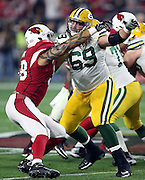 Arizona Cardinals linebacker Jason Babin (44)  tries to work his way around a block by Green Bay Packers tackle David Bakhtiari (69) as he chases the action during the NFL NFC Divisional round playoff football game against the Green Bay Packers on Saturday, Jan. 16, 2016 in Glendale, Ariz. The Cardinals won the game in overtime 26-20. (©Paul Anthony Spinelli)