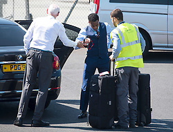 © Licensed to London News Pictures. 06/06/2016. Luton, UK. DANNY ROSE struggles with his bags as he arrives at the airport before Members of England national football squad board a plane at Luton airport in Bedfordshire, England, to head for their training camp in France, ahead of the start of the UEFA Euro 2016 championships.  Photo credit: Ben Cawthra/LNP