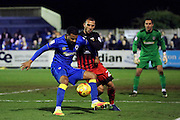 AFC Wimbledon striker Andy Barcham (17) battles for possession withc20\ during the EFL Sky Bet League 1 match between AFC Wimbledon and Coventry City at the Cherry Red Records Stadium, Kingston, England on 14 February 2017. Photo by Matthew Redman.