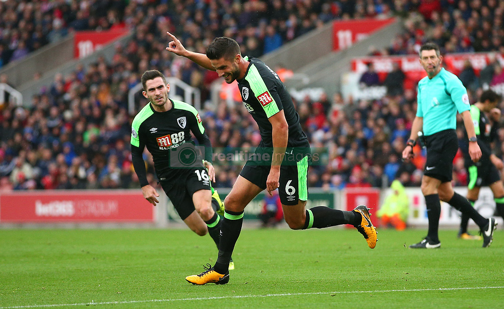 AFC Bournemouth's Andrew Surman celebrates scoring his side's first goal during the Premier League match at the bet365 Stadium, Stoke-on-Trent.