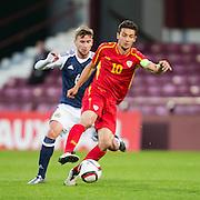 FYR Macedonia's David Babunski and Scotland's Craig Slater during Scotland Under-21 v FYR Macedonia,  UEFA Under 21 championship qualifier  at Tynecastle, Edinburgh. Photo: David Young<br /> <br />  - © David Young - www.davidyoungphoto.co.uk - email: davidyoungphoto@gmail.com