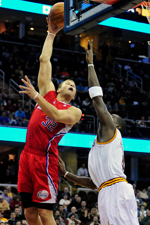 Feb. 11, 2011; Cleveland, OH, USA; Los Angeles Clippers power forward Blake Griffin (32) shoots over Cleveland Cavaliers power forward Antawn Jamison (4) during the first quarter at Quicken Loans Arena. Mandatory Credit: Jason Miller-US PRESSWIRE