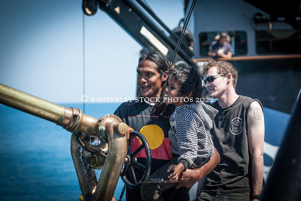 Local man Albert Wiggan with his son on board Sea Shepherd's the Steve Irwin during Operation Kimberley Miinimbi in August 2012.