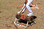 """Woodchopping has been a competitive sport in Australia since at least 1870, and is particularly popular in the state of Tasmania. Here a 14 year old boy competes in the """"Underhand"""" competition. Perth, Western Australia"""