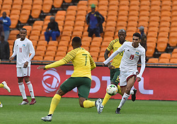 South Africa: Johannesburg: Bafana Bafana players Lebohang Maboe(L) and Sandile Hlanti(R) battle for the ball with Seychelles player Karl Hopprich during the Africa Cup Of Nations qualifiers at FNB stadium, Gauteng.<br />