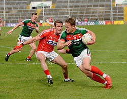 Mayo&rsquo;s Andy Moran rounds his Cork marker during the qualifer at the Gaelic grounds.<br /> Pic Conor McKeown