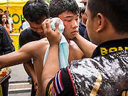 28 JULY 2013 - BANGKOK, THAILAND:  A young boxer is looked after when his bout was called because his opponent cut his face during the ASEAN Muay Thai Championship at MBK shopping center in Bangkok.      PHOTO BY JACK KURTZ