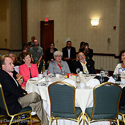 Sen. Jeanne Shaheen, Sen, Martha Fuller Clark, Geoffrey Clark, Kate Murray, and others listen as David Simas, Obama for America Director of Opinion Research speaks at a NH Democratic Party breakfast at the 2012 Democratic National Convention