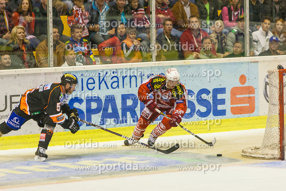 14.09.2012. Stadthalle, Klagenfurt, AUT, EBEL, EC KAC vs Graz 99ers, 03. Runde, im Bild 4:2 durch John Lammers (Kac, #20), Dustin VanBallegoole (Graz 99ers, #5) during the Erste Bank Icehockey League 03rd Round match betweeen EC KAC and Graz 99ers at the City Hall, Klagenfurt, Austria on 2012/09/14. EXPA Pictures © 2012, PhotoCredit: EXPA/ Mag. Gert Steinthaler