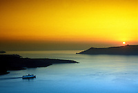 Looking from Fira, the island of Santorini, to  the island of Thirassia at sunset, the Cyclades, Greece