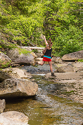 A woman explores Haley Brook near Saddleback Lake in Dallas Plantation, Maine. High Peaks region, near Rangeley.