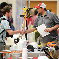 Terry Ray, an eleventh grader at Shannon High School, shakes hands with Josh Logan, Operations Manager with Sportsman Lawn & Landscape, as he visits their booth during the Shannon High School Job Fair Wednesday morning. Lee County Schools new career coaches, provided by the Toyota Wellspring Education Fund, have organized job fairs this school year where local businesses participate and give the students experience talking to the representatives about possible internships or employment.