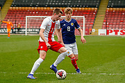 Jakub Kaminski shields the ball from Michael Craig (Tottenham Hotspur) during the U17 European Championships match between Scotland and Poland at Firhill Stadium, Maryhill, Scotland on 26 March 2019.