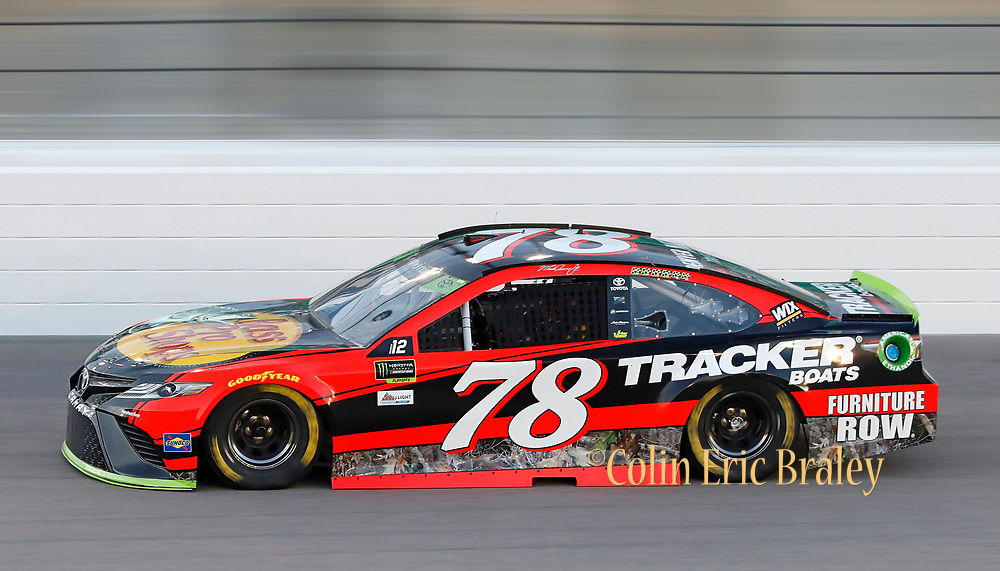 Martin Truex Jr. qualifies for the NASCAR Cup Series auto race at Kansas Speedway in Kansas City, Kan., Friday, Oct. 20, 2017. Truex won the pole with the speed of 188.029 miles per hour. (AP Photo/Colin E. Braley)