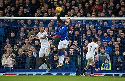 LIVERPOOL, ENGLAND - Sunday, January 24, 2016: Everton's Romelu Lukaku in action against Swansea City's goalkeeper Lukas Fabianski and captain Ashley Williams during the Premier League match at Goodison Park. (Pic by David Rawcliffe/Propaganda)