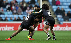 Australia's Justin O'Neill is tackled by New Zealand's Manu Ma'u (left) and Adam Blair during the Four Nations match at the Ricoh Arena, Coventry.