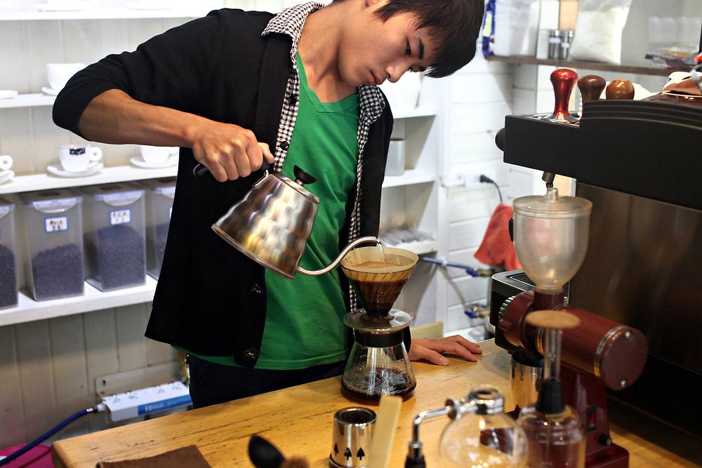 Coffee preparation on Bo'ai Road, Dali, Yunnan, China; September, 2013.