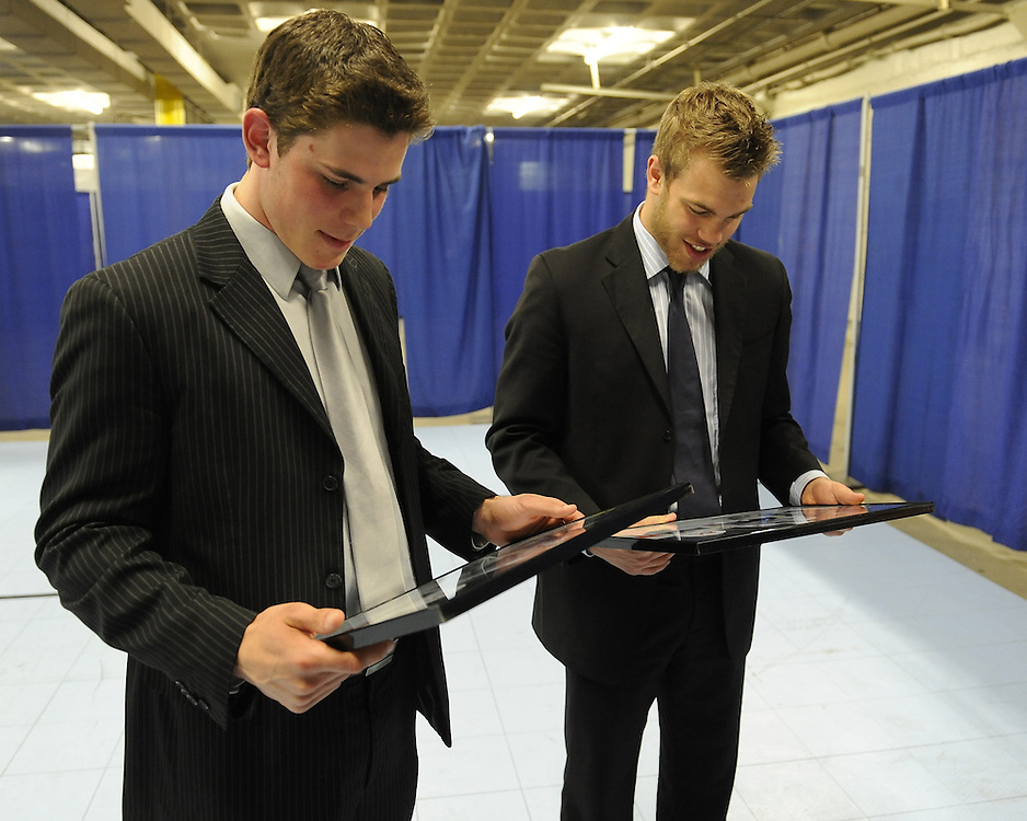 Tyler Seguin (left) of the Plymouth Whalers and Taylor Hall of the Windsor Spitfires look at screen shots of themselves in EA Sports NHL 11 at the Canadian Hockey League media conference at the MasterCard Memorial Cup in Brandon, MB on Friday. Photo by Aaron Bell/CHL Images