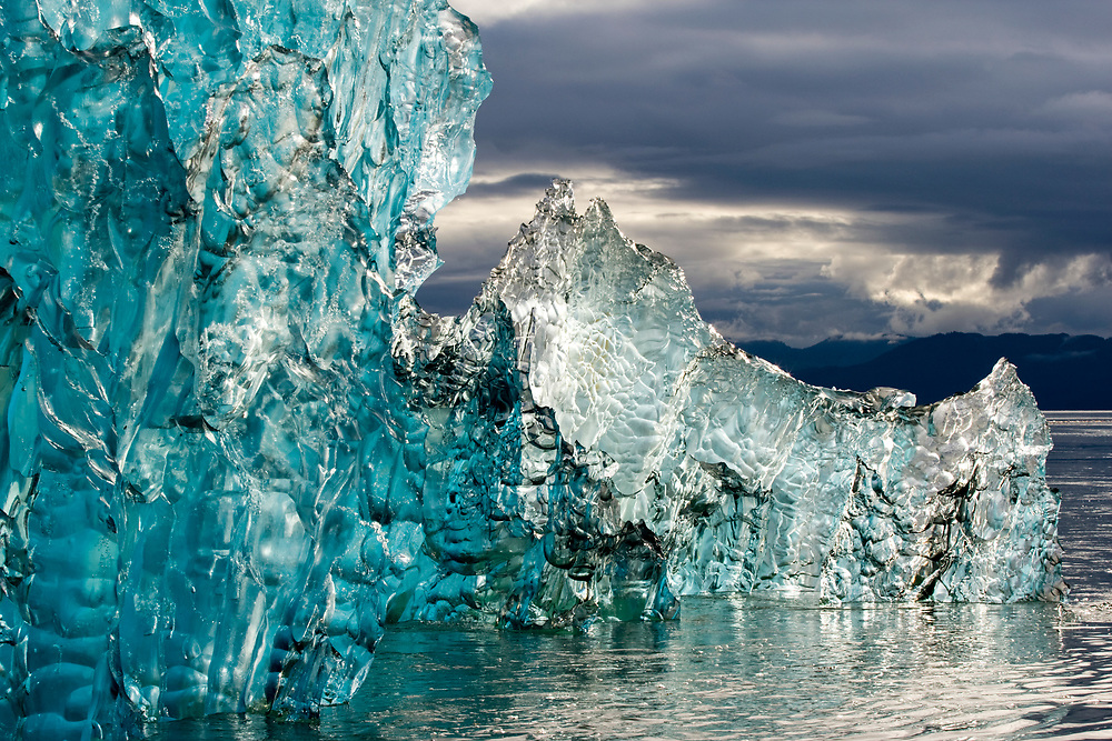 USA, Alaska, Tongass National Forest, Tracy Arm - Fords Terror Wilderness, Deep blue iceberg near entrance to Holkham Bay on summer evening