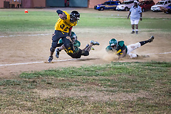 Abraham Weekes tackled on the play.  Avengerz vs. Sharks .  Lionel Roberts Stadium.  St. Thomas, VI.  15 August 2015.  © Aisha-Zakiya Boyd