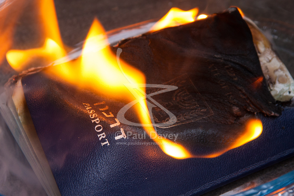, August 4th 2014. Third generation British Jew Sonya Levine's passport burns as she  renounces her Israeli citizenship  to show her disgust at their ongoing attacks against  Gaza.