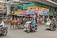 Busy intersection in downtown Laoag, Philippines. Copyright Reid 2015 McNally.